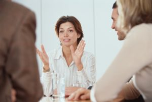 Businesswoman Talking to Colleagues in Meeting